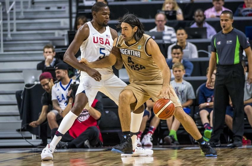 Jul 22, 2016; Las Vegas, NV, USA; Argentina forward Luis Scola (4) is defended by USA guard Kevin Durant (5) during a basketball exhibition game at T-Mobile Arena. USA won 111-74. Mandatory Credit: Joshua Dahl-USA TODAY Sports