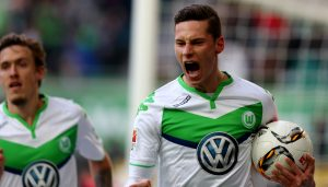 WOLFSBURG, GERMANY - FEBRUARY 13:  Julian Draxler of Wolfsburg celebrates after scoring the opening goal during the Bundesliga match between VfL Wolfsburg and FC Ingolstadt at Volkswagen Arena on February 13, 2016 in Wolfsburg, Germany.  (Photo by Martin Rose/Bongarts/Getty Images)